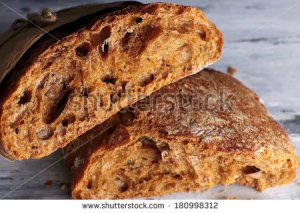 stock-photo-breaking-bread-close-up-180998312