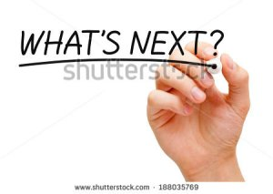stock-photo-hand-writing-what-s-next-with-black-marker-on-transparent-wipe-board-188035769