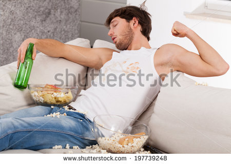 stock-photo-a-drunk-man-lying-on-a-couch-with-popcorn-all-over-the-place-197739248