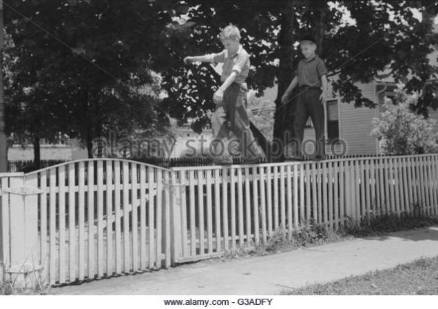 boys-walking-fence-washington-indiana-date-1941-july-g3adfy