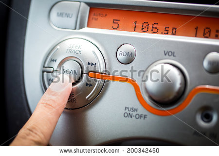 stock-photo-transportation-and-vehicle-concept-man-using-car-audio-stereo-system-200342450