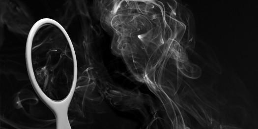 Smoke Woman Gazes into mirror