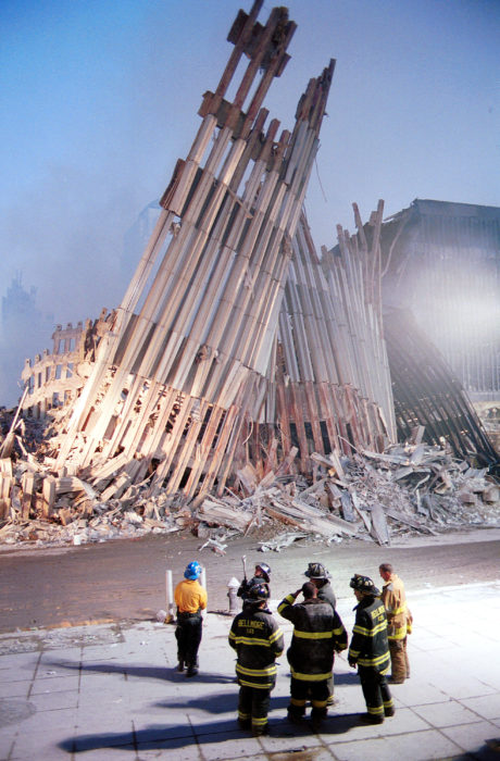 NEW YORK - SEPTEMBER 13, 2001: (SEPTEMBER 11 RETROSPECTIVE) New York City firefighters look at the destroyed facade of the World Trade Center September 13, 2001, two days after the twin towers were destroyed when hit by two hijacked passenger jets in a terrorist attack. (Photo by Chris Hondros/Getty Images)